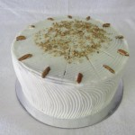 SIZE 28 CM CARROT CAKE (MUDDY) A solid muddy carrot sponge with pineapples and roasted nuts iced with a cream cheese icing.